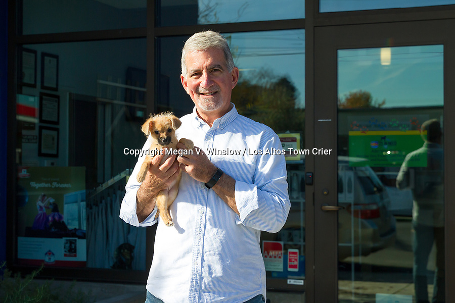 Pets In Need Executive Director Al Mollica poses outside the nonprofit with Melanie, a terrier.