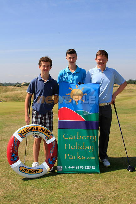 Darragh McCann, Phil Kirk and Max McGloin during The Clogherhead RNLI Annual Golf Classic sponsored by Carberry Holiday Parks at Seapoint Golf Club on Friday 25th July 2014.<br /> Picture:  Thos Caffrey / www.newsfile.ie