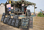 Blackboard offers for fresh fish on sale outside beach shed, Aldeburgh, Suffolk, England