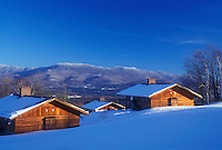 snow-covered chalets, Trapp Family Lodge, lodging, TFL, Stowe, Vermont, VT, Guest houses at the Trapp Family Lodge overlook the scenic mountains in Stowe in the winter.