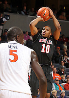 Dec. 22, 2010; Charlottesville, VA, USA; Seattle Redhawks guard Sterling Carter (10) shoots overv Virginia Cavaliers center Assane Sene (5) during the game at the John Paul Jones Arena. Seattle Redhawks won 59-53. Mandatory Credit: Andrew Shurtleff