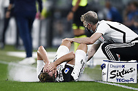 20th July 20202, Allianz Stadium, Turin, Italy; Serie A football league, Juventus versus Lazio; Aaron Ramsey gets physio attention after a heavy challenge
