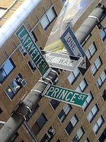 intersection between soho and nolita with a windblown sign
