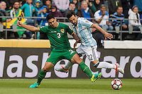 Seattle, WA - Tuesday June 14, 2016: Argentina forward Ezequiel Lavezzi (22)and Bolivia defender Luis Gutierrez (3) during a Copa America Centenario Group D match between Argentina (ARG) and Bolivia (BOL) at CenturyLink Field