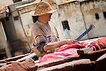 A man works in the tanneries of Fès, Morocco.