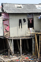 Clothes hanging in a central Jakarta slum.<br />