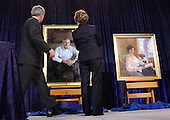 Washington, DC - December 19, 2008 -- United States President George W. Bush and first lady Laura Bush unveil the National Portrait Gallery's Portraits of The President and Mrs. Bush at the National Portrait Gallery in Washington DC, Friday, December 19, 2008..Credit: Ken Cedeno / Pool via CNP
