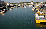 Boats at moorings in the harbour, Weymouth, Dorset, England
