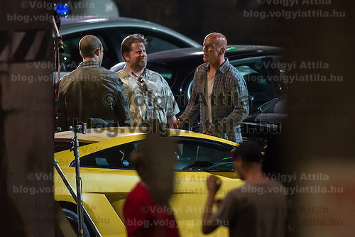 Australian actor Jai Courtney (L) and US actor Bruce Willis (R) participate a rehearsal of a fight schene on set during a shooting of their next movie fifth in the Die Hard series titled Good Day to Die Hard in Budapest, Hungary on July 10, 2012. ATTILA VOLGYI