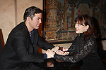 """Meghan Duffy stars in Marrying George Clooney; Confessions from a Middle Crisis presented by the Cap21 Theatre Company and she poses with """"George Clooney"""" on February 16, 2012 at Madame Tussauds Wax Museum, New York City, New York.  (Photo by Sue Coflin/Max Photos)"""