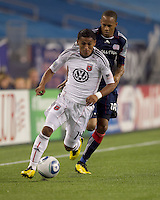 DC United midfielder Andy Najar (14) dribbles down the wing with New England Revolution forward Khano Smith (18) in pursuit. The New England Revolution defeated DC United, 1-0, at Gillette Stadium on August 7, 2010.