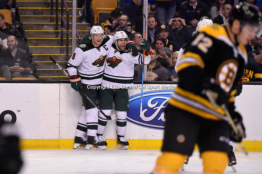 Thursday, November 19, 2015: Minnesota Wild left wing Jason Zucker (16) celebrates his goal with /a9#@/ during the National Hockey League game between the Minnesota Wild and the Boston Bruins held at TD Garden, in Boston, Massachusetts. Eric Canha/CSM