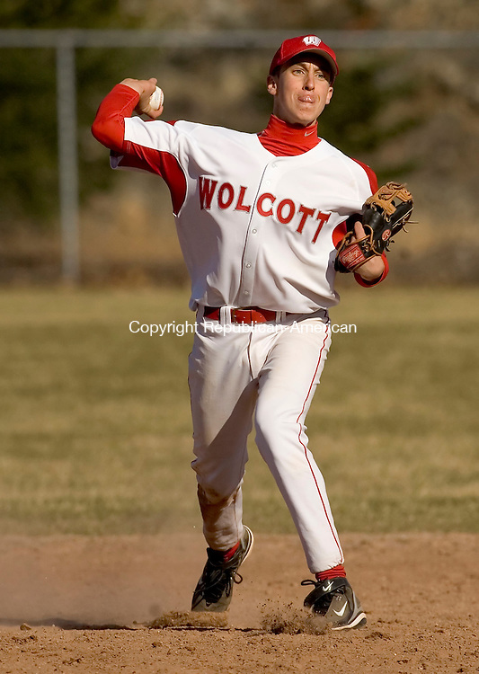 WOLCOTT, CT--09 APRIL 2007--040907JS12-Wolcott's Ryan Pelletier throws to first for an out during their game against Holy Cross Monday at the BAW complex in Wolcott.<br /> Jim Shannon / Republican-American