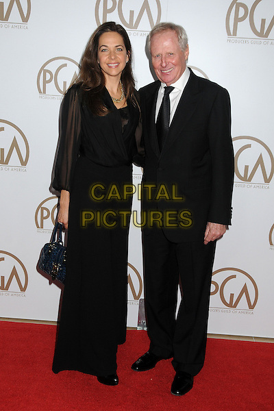 Elise Doganieri, Bertram van Munster.At the 24th Annual Producers Guild Awards held at the Beverly Hilton Hotel, Beverly Hills, California, USA, .26th January 2013..PGAs PGA  full length black dress suit tie .CAP/ADM/BP.©Byron Purvis/AdMedia/Capital Pictures.