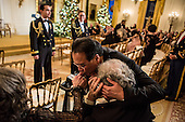 Violinist Yo-Yo Ma kisses the hand of another attendee at the Kennedy Center Honors reception at the White House on December 2, 2012 in Washington, DC. The Kennedy Center Honors recognized seven individuals - Buddy Guy, Dustin Hoffman, David Letterman, Natalia Makarova, John Paul Jones, Jimmy Page, and Robert Plant - for their lifetime contributions to American culture through the performing arts. .Credit: Brendan Hoffman / Pool via CNP