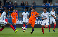 Juninho Bacuna (FC Groningen) of Netherlands & Chris Willock (11) (Benfica) of England U20 during the International friendly match between England U20 and Netherlands U20 at New Bucks Head, Telford, England on 31 August 2017. Photo by Andy Rowland.