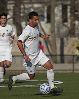 Boston College forward/midfielder Amit Aburmad (7) brings the ball forward.  Rutgers University defeated Boston College in penalty kicks after two overtime periods in NCAA Division I tournament action, at Newton Campus Field, November 20, 2011.