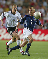 Frankie Hejduk eyes the ball as Christian Ziege closes in. The USA lost to Germany 1-0 in the Quarterfinals of the FIFA World Cup 2002 in South Korea on June 21, 2002.