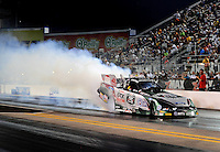 Sept. 17, 2010; Concord, NC, USA; NHRA funny car driver John Force does a burnout during qualifying for the O'Reilly Auto Parts NHRA Nationals at zMax Dragway. Mandatory Credit: Mark J. Rebilas/