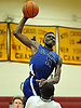 Andre Morgan #13 of Copiague looks to drive to the hoop during a Suffolk County varsity boys' basketball game against host Whitman High School on Tuesday, Dec. 15, 2015. He scored 16 points in Copiague's 54-34 win.