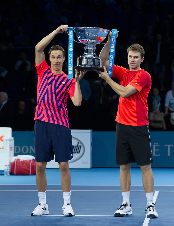 Henri Kontinen of Finland (left) and John Peers of Australia win the Doubles Championship against Raven Klaasen of South Africa and Rajeev Ram of the U.S in the men's Doubles Final match on day eight of the ATP World Tour Finals <br /> <br /> Photographer Ashley Western/CameraSport<br /> <br /> International Tennis - Barclays ATP World Tour Finals - Day 8 - Sunday 20th November 2016 - O2 Arena - London<br /> <br /> World Copyright © 2016 CameraSport. All rights reserved. 43 Linden Ave. Countesthorpe. Leicester. England. LE8 5PG - Tel: +44 (0) 116 277 4147 - admin@camerasport.com - www.camerasport.com