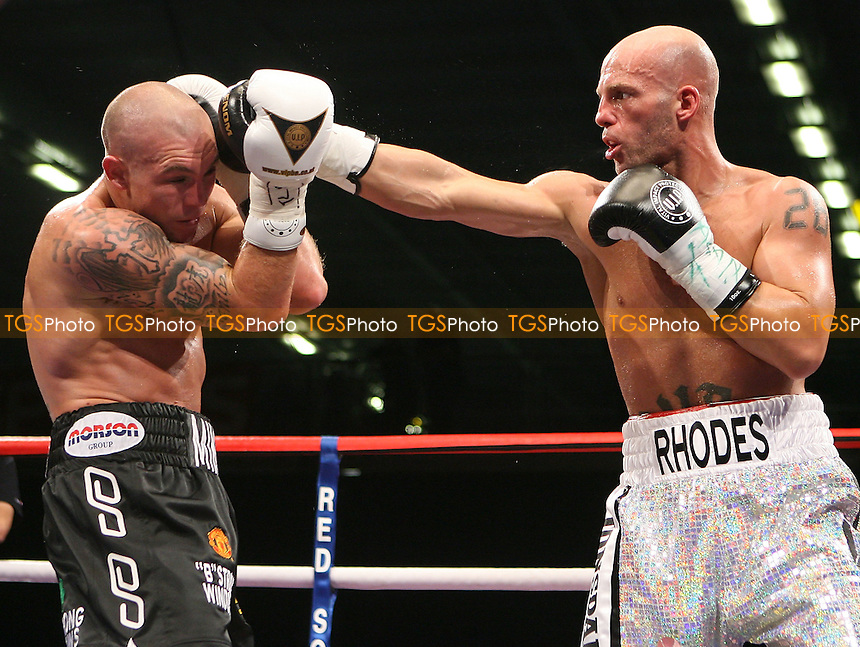 Ryan Rhodes (white shorts) defeats Jamie Morre in a Light-Middleweight Boxing contest for the European EBU Title at the Bolton Arena, promoted by Frank Maloney - 23/10/09 - MANDATORY CREDIT: Chris Royle/TGSPHOTO - Self billing applies where appropriate - Tel: 0845 094 6026.