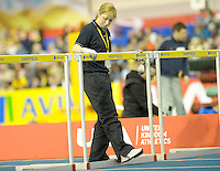 Photo: Ady Kerry/Richard Lane Photography.. Aviva European Trials and UK Championships, 15/02/2009..Event staff put out the hurdles for the 60m heats.