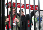 28 April 2007: Two Toronto fans wait for the gates to the stadium to open. Major League Soccer expansion team Toronto FC lost 1-0 to the Kansas City Wizards in the inaugural game at BMO Field in Toronto, Ontario, Canada, the first MLS game played outside of the United States.