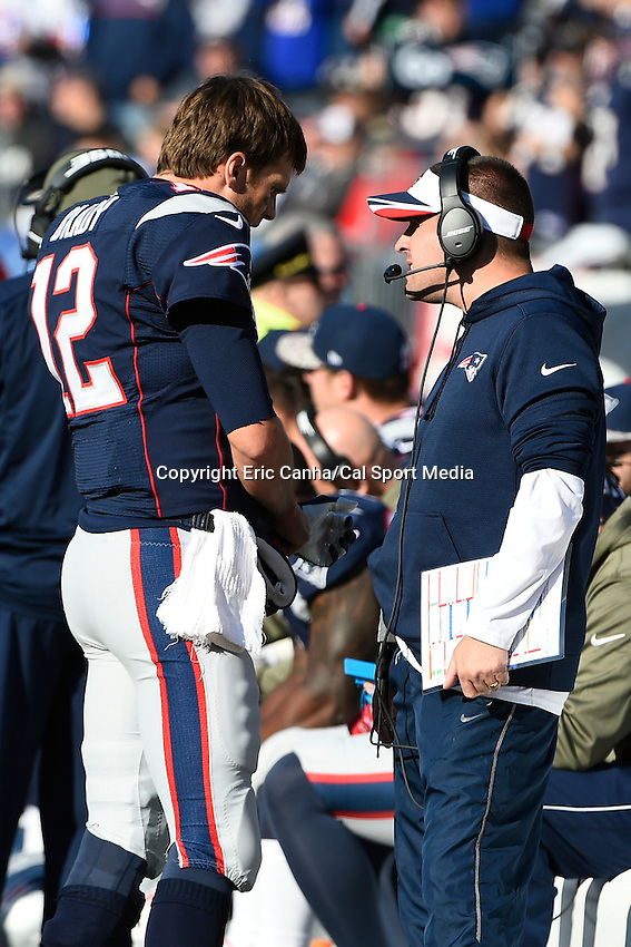 November 23, 2014 - Foxborough, Massachusetts, U.S.- New England Patriots quarterback Tom Brady (12) talks to offensive coordinator Josh McDaniels during the NFL game between the Detroit Lions and the New England Patriots held at Gillette Stadium in Foxborough Massachusetts. The Patriots defeated the Lions 34-9. Eric Canha/CSM
