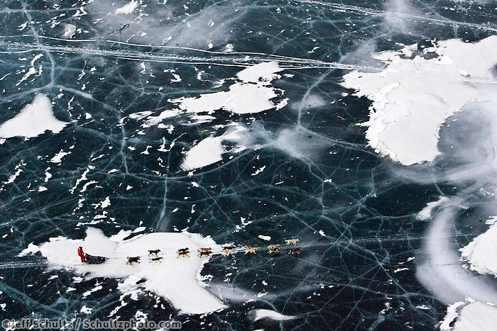 Aerial of Jason Barron traveling on the glare ice of one of the Farewell Lakes on Tuesday during Iditarod 2008