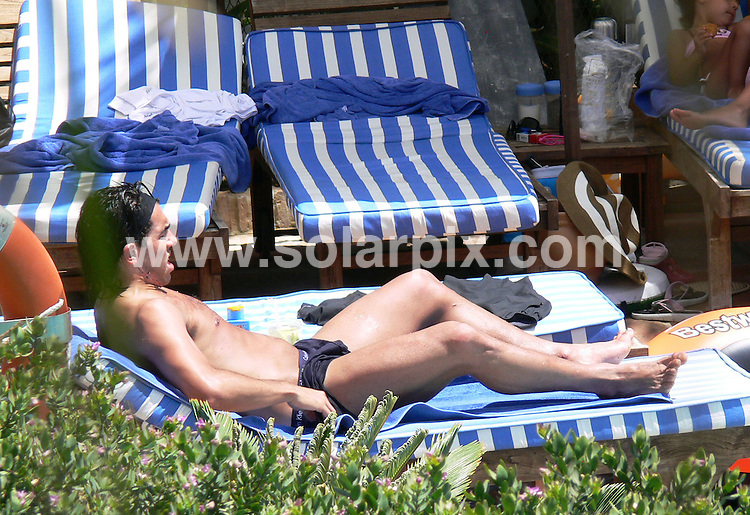 **ALL ROUND EXCLUSIVE PICTURES FROM SOLARPIX.COM**.**WORLDWIDE SYNDICATION RIGHTS**.**NO PUBLICATION IN SPAIN**.Carlos Tevez, pictured enjoying a short break in Spain's Costa del Sol, together with his wife Vanessa, daughter Florencia and family friends. The family enjoyed the sunshine by splashing about in the pool and sunbathing. Costa del Sol, Spain. ..the Argentinian football player has been playing on loan for UEFA Champions League and Premier League champions Manchester United, but is currently in talks for an permanent transfer which is thought could be in the region of £35 Million..29th July 2008..This pic: Carlos Tevez..JOB REF: 6927 CS1        DATE: 29_07_2008.**MUST CREDIT SOLARPIX.COM OR DOUBLE FEE WILL BE CHARGED* *UNDER NO CIRCUMSTANCES IS THIS IMAGE TO BE REPRODUCED FOR ANY ONLINE EDITION WITHOUT PRIOR PERMISSION*