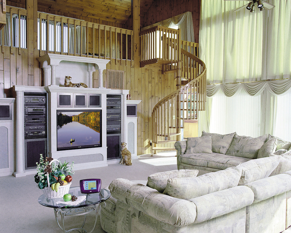 Living Area With Loft And Winding Staircase