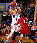 BROOKINGS, SD - DECEMBER 3: Macy Miller #12 from South Dakota State is pressured by Jazmine Jones #23 from Louisville during their game Sunday afternoon at Frost Arena in Brookings, SD.  (Photo by Dave Eggen/Inertia)