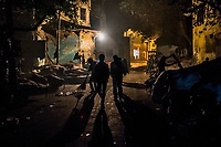 OLD DELHI, INDIA, JANUARY 11, 2016: Men walk along a street where people sleep at a sleep market from where they rented a blanket on January 11, 2016 in Old Delhi, India. <br /> Daniel Berehulak for The New York Times