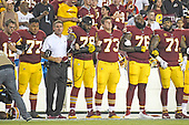 "From left to right: Washington Redskins quarterback Colt McCoy (12), offensive guard Shawn Lauvao (77), head coach Jay Gruden, offensive tackle Ty Nsekhe (79), center Chase Roullier (73), offensive tackle Morgan Moses (76), and offensive tackle Trent Williams (71) lock arms in solidarity as the national anthem is sung prior to the game against the Oakland Raiders at FedEx Field in Landover, Maryland on Sunday, September 24, 2017.  The Redskins chose to demonstrate prior to their nationally televised contest following tweets earlier in the day from United States President Donald J. Trump urging owners to ""fire or suspend"" players who participated in the protests by not standing for the anthem.<br /> Credit: Ron Sachs / CNP"