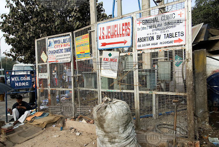 Advertisements for diagnostic clinics and abortions at Yusuf Sarai Market in south Delhi.