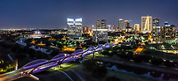 We capture this aerial panorama image at twilight of the Fort Worth skyline with the Seventh Street bridge as it crosses the Trinity River in downtown. The 7th street bridge was lighted with purple led light so it really popped in this image of the cityscape. The seventh street bridge led light seem to change colors every day so that was a nice treat.  Fort Worth is the fifth largest city in Texas.  Ft Worth is located in central north part of Texas and the county seat is Tarrant County.  The latest census is that the population for Fort Worth is estimates, at around  854,113. The city is the second-largest in the Dallas–Fort Worth–Arlington metropolitan area  or the DFW Metro.