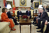 United States President Donald J. Trump and US Vice President Mike Pence meet with Congressional leadership including US House Minority Leader Nancy Pelosi (Democrat of California), US House Speaker Paul Ryan, (Republican of Wisconsin), US Senate Majority Leader Mitch McConnell (Republican of Kentucky), US Senate Minority Leader Charles Schumer (Democrat of New York) and US Secretary of Defense Jim Mattis in the Oval Office  of the White House , December 7, 2017 in Washington, DC.  <br /> Credit: Olivier Douliery / Pool via CNP