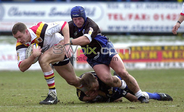 Pix:Ben Duffy/SWpix...Silk Cut Challenge Cup-Halifax Blue Sox v Bradford Bulls....25/02/2001..COPYRIGHT PICTURE>>SIMON WILKINSON..Halifax's Johnny Lawless and Andrew Dunemanmn hold onto Bradford's Jamie Peacock