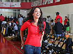 TRACEY EDMONDS watches the Prime Prep Academy Basketball team from Prime Prep Academy, the charter school Dion Sanders helped co-found, at the 2014 Metroplex Challenge at South Grand Prairie High School in Grand Prairie, Texas.
