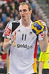Nach 167 L&auml;nderspielen mit 576 Toren beendet Holger Glandorf seine Karriere in der deutschen Handball-Nationalmannschaft. Der 31-j&auml;hrige Linksh&auml;nder war 2007 Weltmeister und gewann im Juni mit der SG Flensburg-Handewitt die Champions League<br /> Archiv aus: <br />  05.11.2011. TUI Arena, GER, Hannover, Handball Supercup 2011, Deutshcland (GER) vs Schweden (SWE), im Bild  Handball Supercup 2011. Aus Germany (Wei&szlig;) gegen Schweden 22:25 am 05.11.2011 in der TUI Arena in Hannover. Im Foto: Am Ball DHB Spieler Holger Glandorf #11. Foto &copy; nph / Rust *** Local Caption ***
