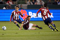 CD Chivas USA midfielder Francisco 'Ponchito' Mendoza (6) moves past Rapids midfielder Brian Mullan (11). The Colorado Rapids defeated CD Chivas USA 1-0 at Home Depot Center stadium in Carson, California on Saturday March 26, 2011...