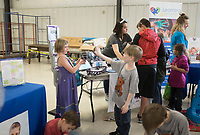 NWA Democrat-Gazette/CHARLIE KAIJO Kids play wth a variety of toys geared towards kids with autism during the Autism Involves Me annual walk, Saturday, May 4, 2019 at the Benton County Fairgrounds in Bentonville. <br /><br />Autism Involves Me, a Bentonville non-profit, held its annual walk to highlight the lack of services for kids with autism.