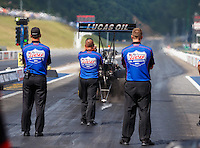 Jun 18, 2016; Bristol, TN, USA; Crew members look on as NHRA top fuel driver Richie Crampton launches off the starting line during qualifying for the Thunder Valley Nationals at Bristol Dragway. Mandatory Credit: Mark J. Rebilas-USA TODAY Sports