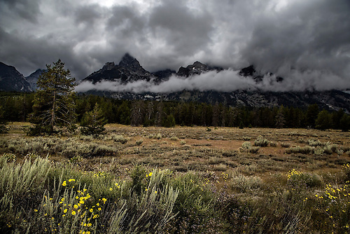 Storm clouds pass through the Teton Mountain Range at Grand Teton National Park, Wyoming