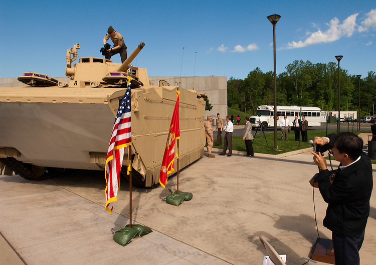 "WASHINGTON, DC - May 4: Binh Vinh, right, of Thermally Engineered Manufactured Products (T.E.M.P.) takes a picture of the U.S. Marines' newest Expeditionary Fighting Vehicle (EFV) prototype as it sits in front of the National Museum of the Marine Corps in Triangle. Va., before its unveiling ceremony. The armored amphibious vehicle is designed carry 17 combatants, plus a three person crew, from Navy ship ""beyond the horizon"" to objectives inland. The ceremony was held at the(Photo by Scott J. Ferrell/Congressional Quarterly)"