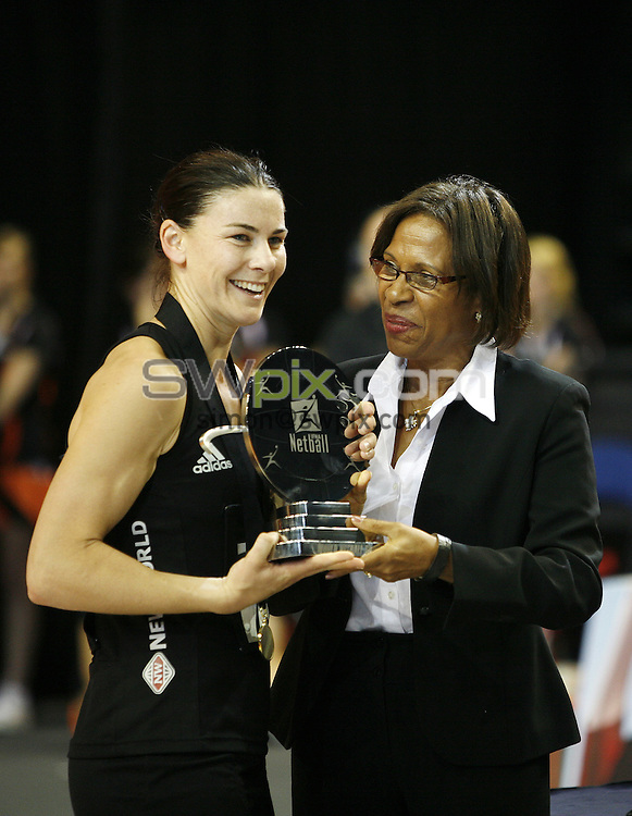 PICTURE BY VAUGHN RIDLEY/SWPIX.COM - Netball - World Netball Series 2010 - England v New Zealand Final - Echo Arena, Liverpool, England - 21/11/10...Copyright - Simon Wilkinson - 07811267706...IFNA President Molly Rhone presents the Championship Trophy to New Zealand Captain Maree Bowden.