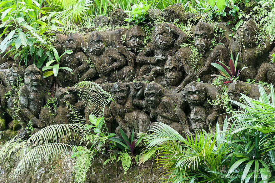 Ubud, Bali, Indonesia; stone monkey sculptures on the grounds of the Tjampuhan Hotel