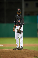 Batavia Muckdogs relief pitcher C.J. Carter (11) looks in for the sign during a game against the West Virginia Black Bears on July 2, 2018 at Dwyer Stadium in Batavia, New York.  West Virginia defeated Batavia 3-1.  (Mike Janes/Four Seam Images)