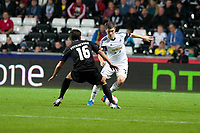 Thursday  03 October  2013  Pictured: Ben Davies gets the ball past of St.Gallen's Matias Vitkieviez<br /> Re:UEFA Europa League, Swansea City FC vs FC St.Gallen,  at the Liberty Staduim Swansea